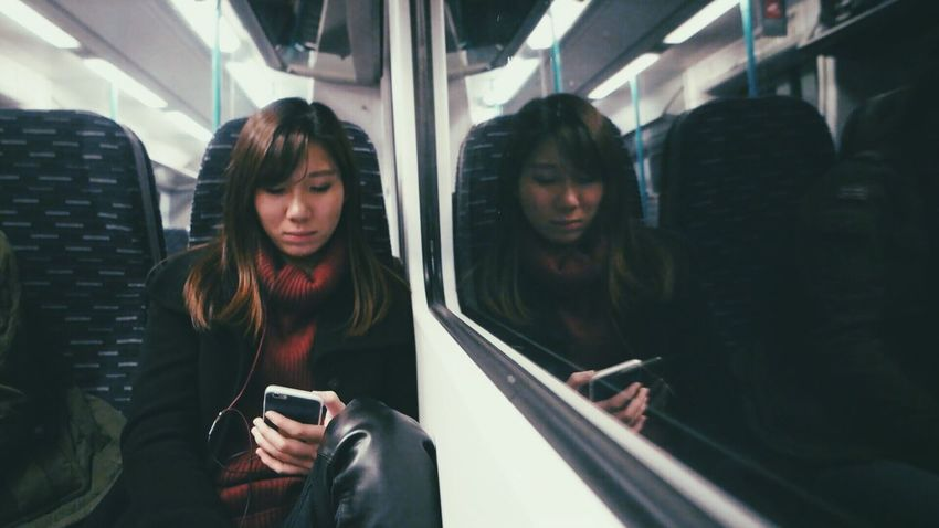 I'm the girl on the train Communication Mobile Phone Subway Train On The Move Public Transportation Travel Technology Mode Of Transport Transportation Smart Phone Young Adult Train Interior Train TheGirl Mood