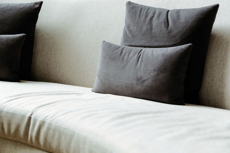 Midsection of sofa on bed at home