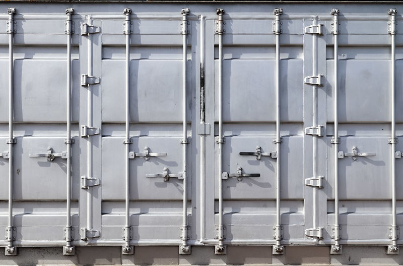Detailed close up view on metal and steel surfaces on a silver cargo containter