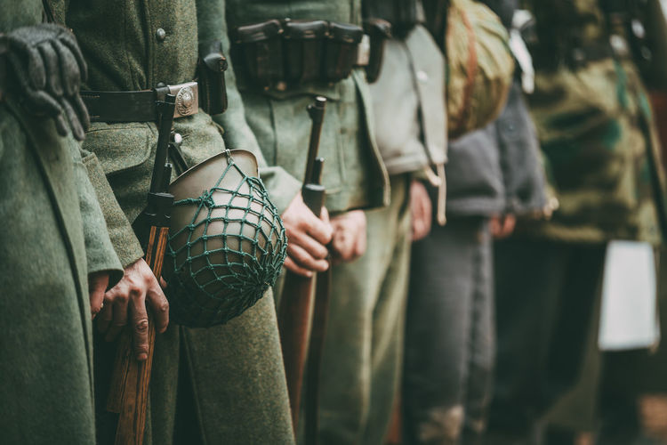 Close Up Of German Military Ammunition Of A German Soldier. Unidentified Re-enactors Dressed As World War Ii German Soldiers Standing Order. Military Uniform Army War Ww2 WWII Ww1 Front Uniform Ussr Millitary German Ammunition Soldier Re-enactors Weapon Gun Wehrmacht History