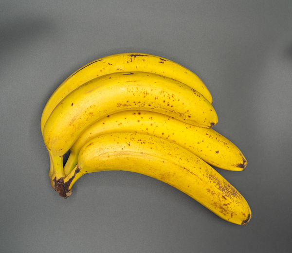 Directly above shot of yellow fruit against white background