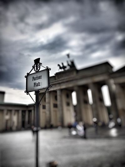 Text Western Script Communication Sky Architecture Built Structure Building Exterior Cloud - Sky Outdoors Focus On Foreground Day Road Sign No People Berlin Berlin Mitte Berlin Photography