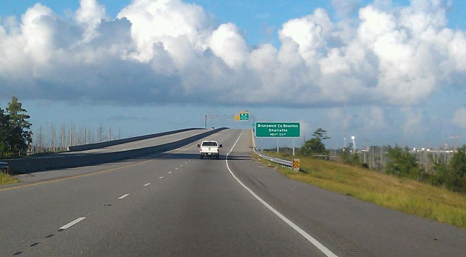 Road The Way Forward Road Sign Cloud - Sky Direction Highway Sky Transportation No People Tranquility Day Outdoors Road Trip City Street Photography Built Structure