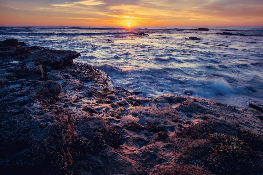 Outdoors Water Scenics Sunset Sea Nature Beauty In Nature Tranquil Scene Tranquility Horizon Over Water Sky No People Rock - Object Wave Beach Day
