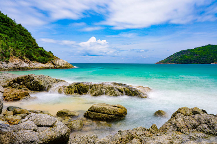 Seascape rock coast in summer. at coast phuket thailand Water Beauty In Nature Scenics - Nature Sea Sky Rock Cloud - Sky Land Rock - Object Tranquility Tranquil Scene Solid Idyllic Beach Nature Horizon Over Water No People Non-urban Scene Day Turquoise Colored Rocky Coastline