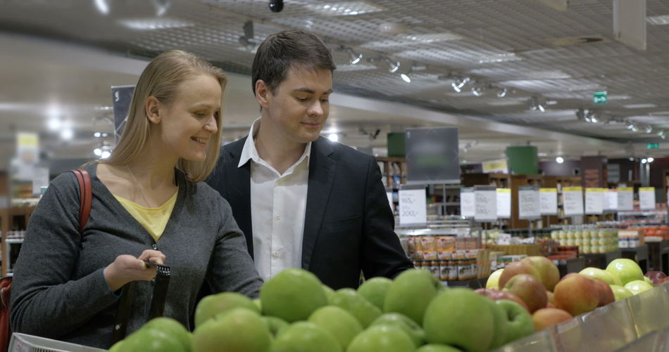 People looking at market stall in store