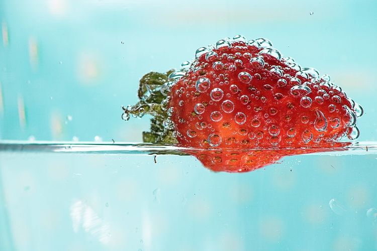Strawberry covered in bubbles floating in water, pastel blue background Refreshing :) Summer Strawberry EyeEm Selects Pastel Background Close-up Floating In Water Carbonated