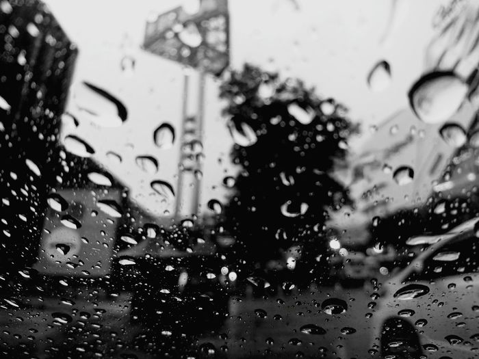 Wet Glass - Material Transportation Car Rain Drop Window Vehicle Interior Water Weather Land Vehicle Transparent Car Interior Windshield Mode Of Transport Focus On Foreground Close-up RainDrop Rainy Season No People