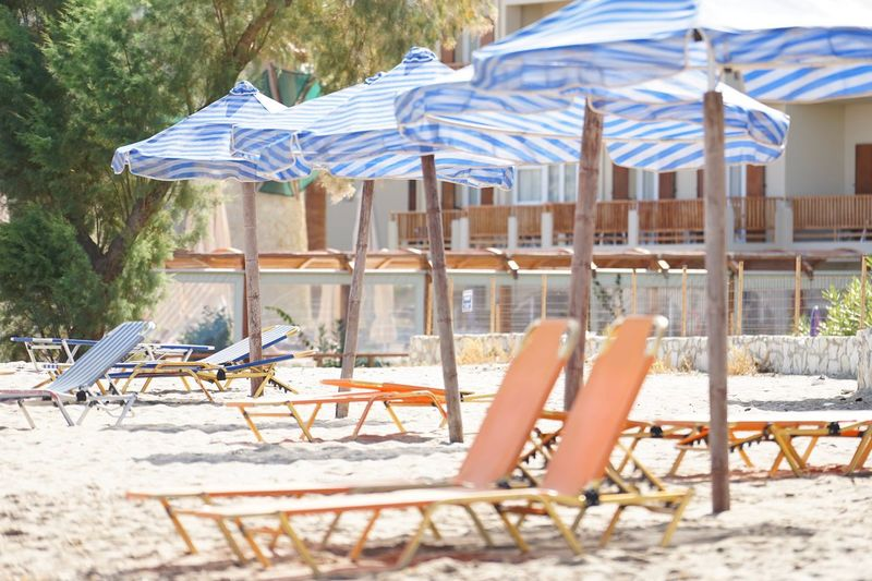Deck Chairs Umbrellas Parasols Sun Loungers Beach Life Chair Day Absence Sand Outdoors Beach No People Outdoor Chair Sunlight Vacations Relaxation