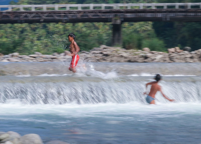 kids playing in the river in a broad day light Water Splashing Motion Leisure Activity Enjoyment Childhood Blurred Motion Real People Wet Happiness Fun Two People Full Length Outdoors Children River Eyeem Market Canonphotography Eyeem Philippines From My Point Of View Playtime