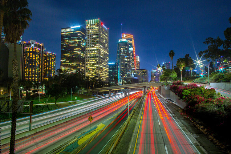 Los Angeles, California City Building Exterior Long Exposure Illuminated Architecture Night Built Structure Speed Motion Light Trail Street Blurred Motion Sky Road Transportation City Life Building Cityscape No People Nature Office Building Exterior Skyscraper Outdoors Modern