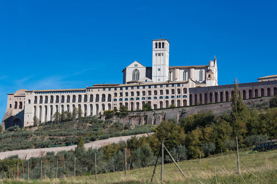Abbey Basilica Catholic Church Nature Saint Francis Of Assisi Architecture Blue Building Exterior Day History Italy No People Outdoors Pilgrimage Religion Sky Tree Umbria