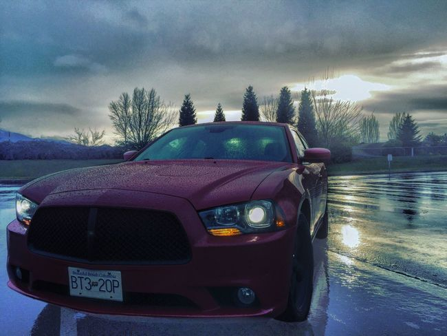 Here another beauty shot :) Sky Sunset Cloud - Sky No People Outdoors Day Rallye Sxt Mopar Moparfam Dodge Charger Dodgecharger Picturetaking Modernmuscle Chargerfam Weather Nature Scenics Moparornocar Tree Car Parking
