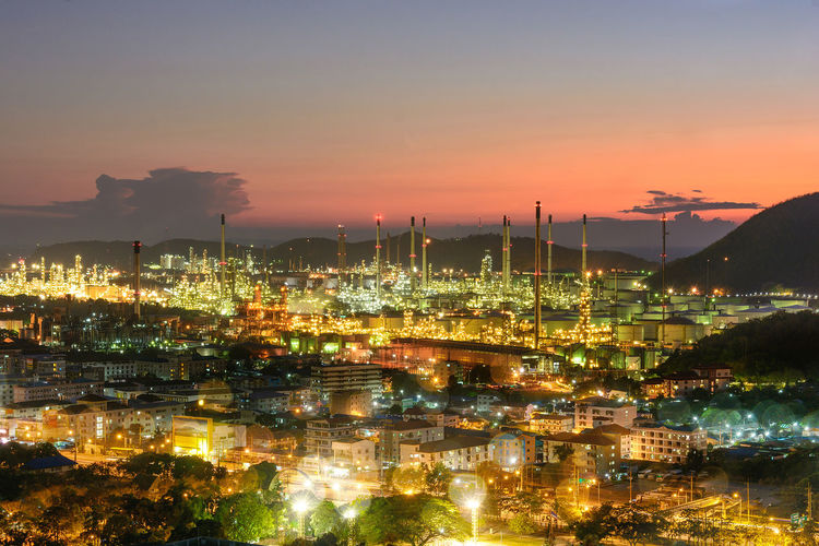 Night refinery Building Exterior Architecture Sky Illuminated Built Structure Sunset Factory Industry No People City Nature Smoke - Physical Structure Water Smoke Stack Cityscape Outdoors Night Mountain Fuel And Power Generation Pollution Industry Light Oil Oil Refinery
