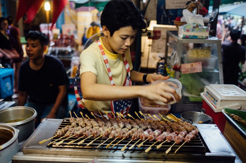 Barbecue Focus On Foreground Food Food And Drink For Sale Freshness Grilled Healthy Eating Incidental People Market Market Stall Meat Night Outdoors People Preparation  Ready-to-eat Real People Retail  Skewer Small Business