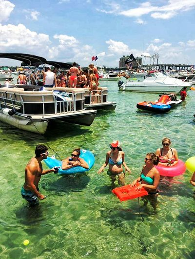 Boating Water Activities Watersports Outdoor Activities Paddle Rafting Playing In The Water Boat People Beach People People Partying Celebrating Holiday Partying With Friends Swimming Ocean Rafting The Essence Of Summer The Great Outdoors – 2016 EyeEm Awards The Street Photographer - 2016 EyeEm Awards Everyday Emotion Destin,Florida, USA People Of The Oceans this is Crab Island in Destin, Florida, USA the locals have a place they get away to away from the Friends And Familythey bring their boats and anchor them next to each other. they wade, swim,raft but most importantly,visit with friends and family and connect with the love of ocean life.