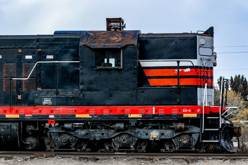 Semi-abandoned train / haul engine. Abandoned Black Deterioration Engine Haul Engine Land Vehicle Mode Of Transport No People Outdoors Parked Railroad Railway Red Run-down Stationary Train