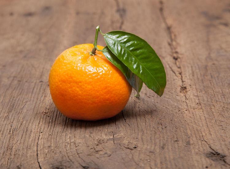 Fine tangerine on wooden background Citrus  Citrus Fruit Food And Drink Freshness Fruit Fruit Flavor Manderine Orange Tangerine