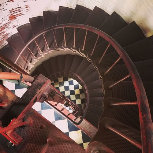 Cape Hatteras lighthouse, interior. (NC) Cape Hatteras Lighthouse Spiral Staircase Spiral Stairs Architecture History Lighthouse_lovers Lighthousephotography Metal No People Railing Red Stairs Spiral Spiral Staircase Staircase Staircase Perspective Staircase Vertigo Steps And Staircases Travel Winding Stairs