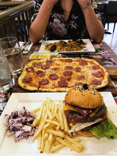 Food is life. Pizza Pepperoni Burger Food Food And Drink Ready-to-eat Freshness Table One Person Plate Unhealthy Eating Indulgence Meal Restaurant 10