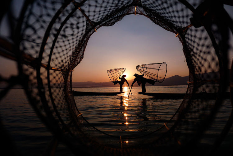 Fishing in Inle Lake, Myanmar Water Sea Sunset Beach Nature Horizon Over Water Sky Beauty In Nature People Fishing Vacations