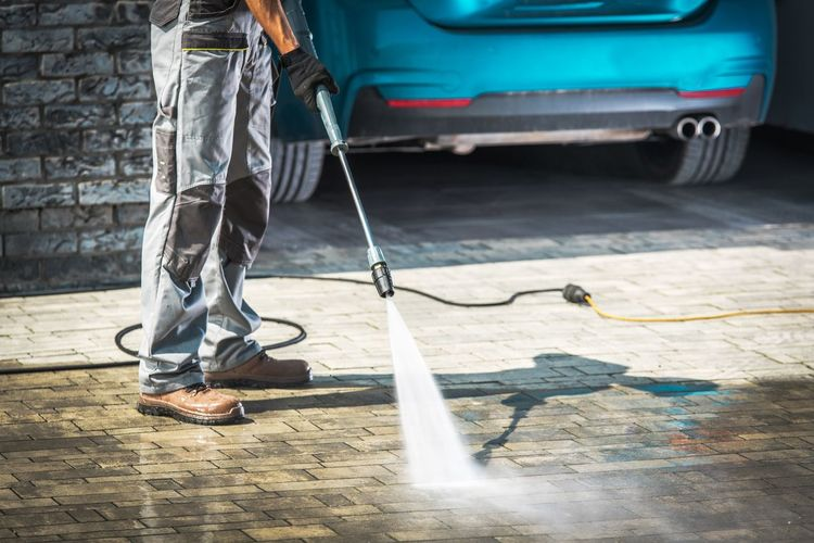 Cobble Driveway Pressure Washing by Caucasian Worker. Pressure Washer Cobblestone Pavement Driveway Cleaning Washing Low Section Transportation Motor Vehicle Sidewalk Real People