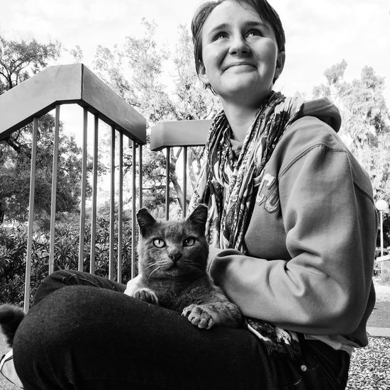 "Dannie and the feral ""physics cat"" Domestic Cat California Feral Cat Spayed Sunset Blackandwhite Student Life Destressing Real People One Animal Looking At Camera Sitted One Person (null)Animal Themes Happiness Outdoors"