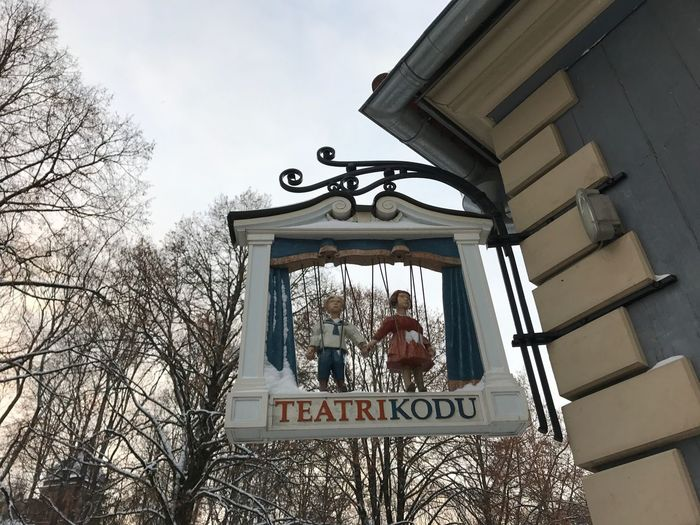 A sign outside the Teatri Kodu in Tartu, Estonia Building Exterior Low Angle View Built Structure Sky Architecture Outdoors Day Bare Tree Snow