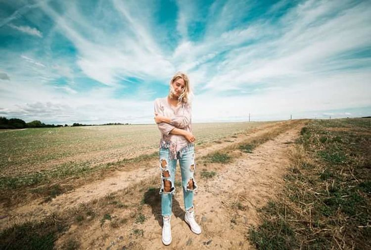 My human EyEmNewHere Check This Out Today's Hot Look EyeEm Best Shots EyeEm Gallery EyeEm Selects Nature EyeEm Nature Lover Bestoftheday Doglover Day Blond Hair Young Women Full Length Rural Scene Beautiful Woman Long Hair Summer Front View Women Field