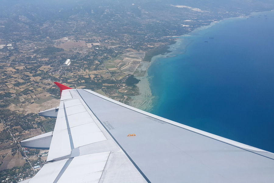 Banking Aircraft Aircraft Wing Aircraft In The Sky Land And Sea Window Seat Privileges Airplane View Flying Over Cebu Domestic Flight Cebu Wanderers Landing