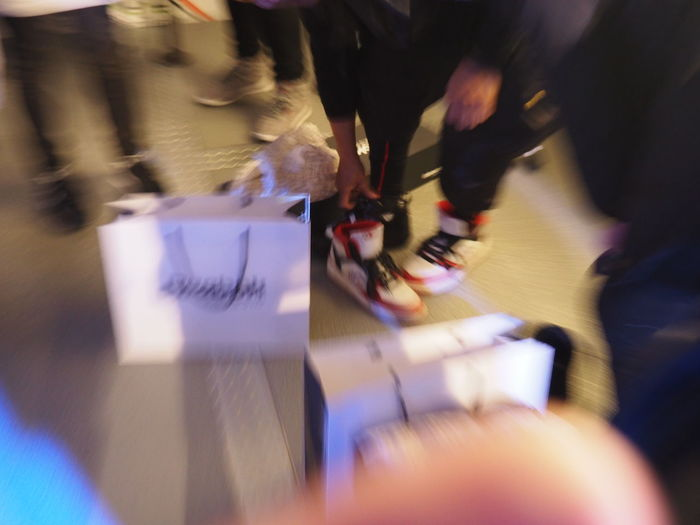 Blurred Motion Buying Choosing Day Fashion Focus On Background Human Body Part Human Hand Indoors  Low Section Motion One Person People Real People Retail Store Selective Focus Shopping Sneaker Sneakers Walking Shop