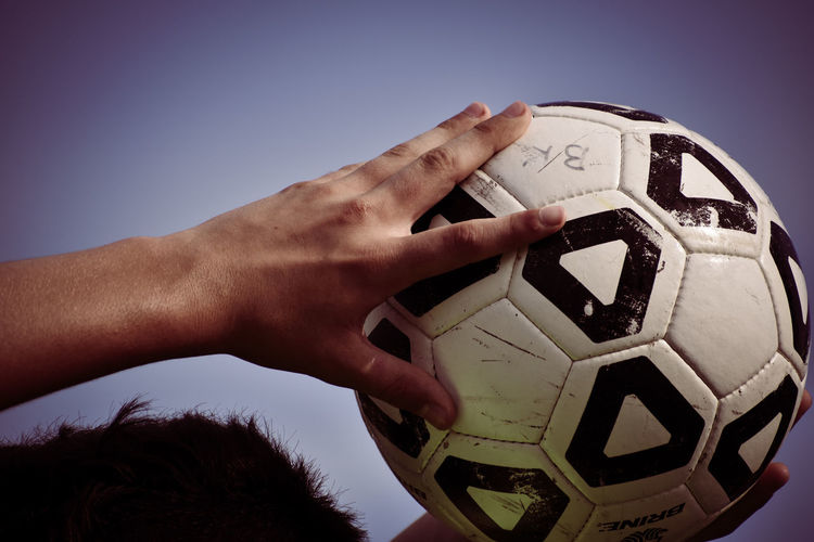 Athlete Ball Clear Sky Close-up Competition Competitive Sport Day Human Body Part Human Hand Men One Person Outdoors Playing Sky Soccer Soccer Ball Soccer Field Soccer Player Sport Sports Team Team Sport
