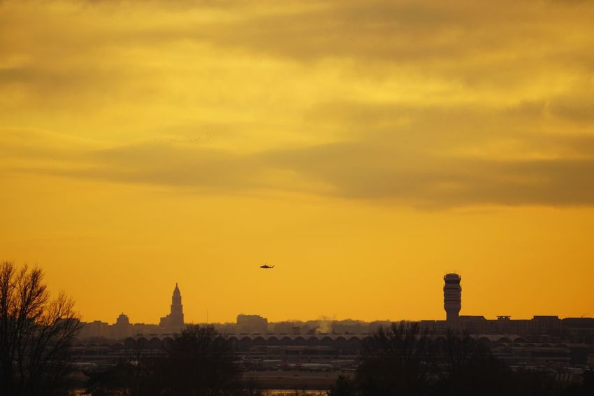 National Airport in Arlington, VA - taken from Washington DC. Also visible are portions of Alexandria, VA Sky Sunset Washington DC Alexandria, VA Arlington, Virginia Airport Control Tower Skyline Urban Landscape Sunset Architecture Built Structure Sky Building Exterior Silhouette Flying City Outdoors Mid-air No People Tree Yellow Cityscape Day