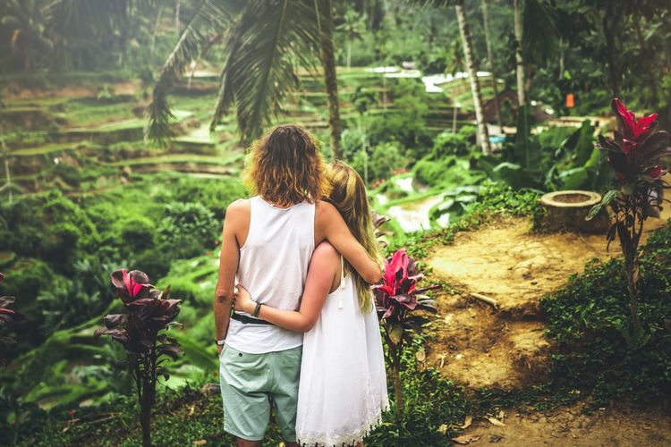 Tourists in terraces. Rice Field Bali, Indonesia Bali INDONESIA Couple Man Plant Rear View One Person Nature Growth Flower Real People Beauty In Nature Lifestyles Women Flowering Plant Leisure Activity Tree Adult Day Green Color Three Quarter Length Hairstyle Outdoors Gardening