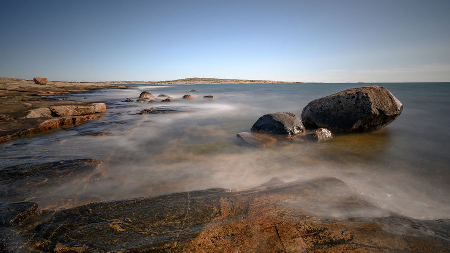 Rock Sky Scenics - Nature Solid Rock - Object Beauty In Nature Water Tranquil Scene Non-urban Scene Nature Tranquility Idyllic Land No People Rock Formation Motion Sea Clear Sky Day Outdoors Hot Spring Power In Nature