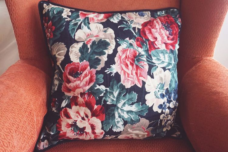 Flower patterned cushion on old chair Interior Style Home Interior Coral Colored Living Coral Still Life Interior Decorating Textile Fabric Interior Close-up Floral Pattern Pillow Cushion Chair Floral Pattern Pattern Human Body Part High Angle View Indoors  Close-up One Person Red Furniture Sofa