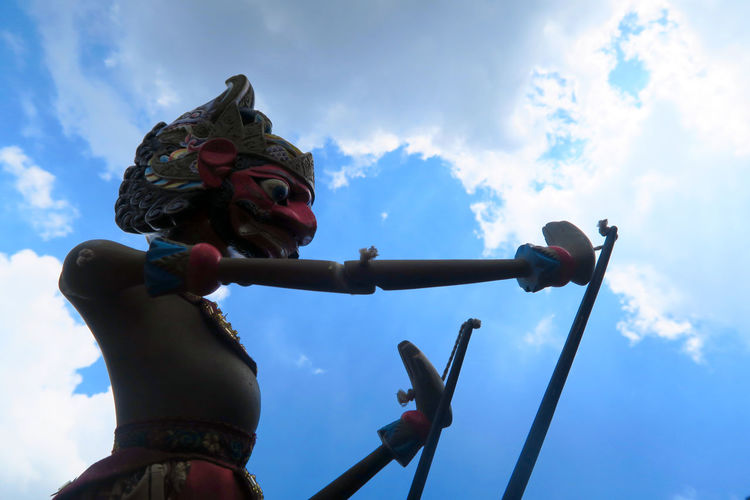 Low angle view of puppet against sky