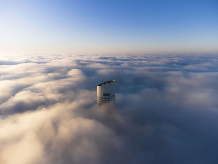 Buenos aires is covered in a fog that makes all buildings invisible, except one. the alvear tower.