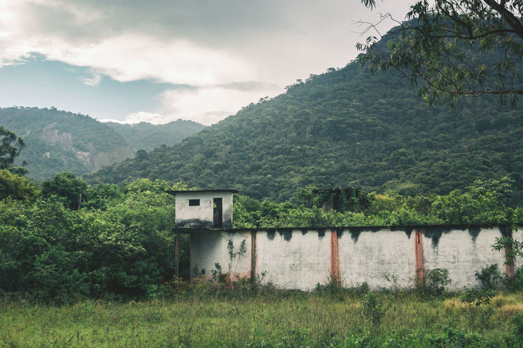 Abandoned prison at Dois Rios on Ilha Grande. Abandoned Abandoned Places Architecture Building Exterior Built Structure Concrete Concrete Jungle Concrete Wall Day Grass Green Color House Landscape Mountain Nature Nature No People Outdoors Plant Prison Ruins Scenics Sky Tower Tree Neighborhood Map The Great Outdoors - 2017 EyeEm Awards EyeEm Selects Lost In The Landscape Going Remote The Great Outdoors - 2018 EyeEm Awards