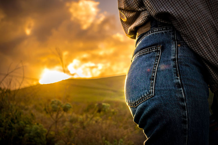 Sun Light Booty Booty Jeans Golden Hour Field Cloud - Sky One Person Human Body Part Casual Clothing Sky Textile Midsection Sunset Nature Body Part Human Leg Denim Land Real People Leisure Activity Men Low Section Lifestyles Adult Outdoors