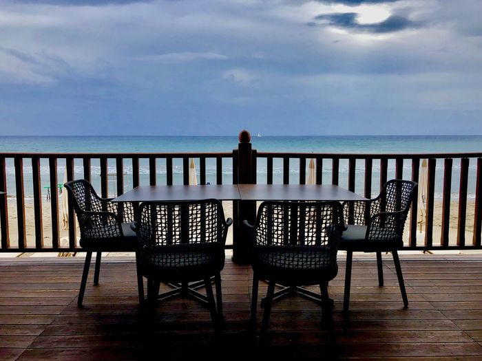 Table and Chair Sky Seat Chair Horizon Horizon Over Water Sea Cloud - Sky Chair Water Table Beach Railing Tranquil Scene