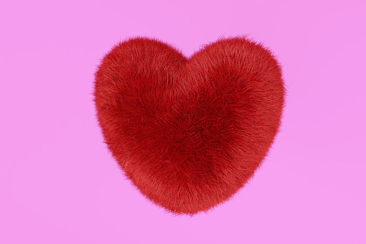 Close-up of heart shape against pink background