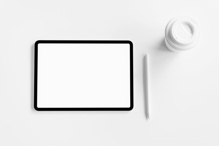 Tablet screen blank on the table mock up to promote your products. Concept of future and trend internet for easy access to information. Copy Space Technology White Color No People Blank Indoors  Studio Shot Wireless Technology Connection Digital Tablet White Background Empty Computer Picture Frame Device Screen Communication Creativity Cut Out Screen Simplicity