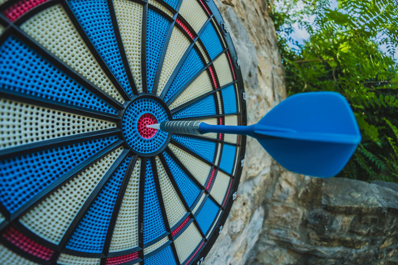 Low angle view of dart in dartboard outdoors