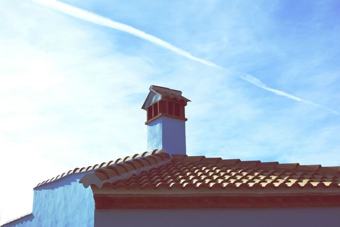 Architecture No People Low Angle View Outdoors Sky Day Mediterranean  Travel Spaın Architecture Cold Temperature Built Structure House Life Style Roof Spanish Town Spanish Culture Blue Architectural Detail Architecture_collection Blue Sky Blue House Chimney Chimney Bricks