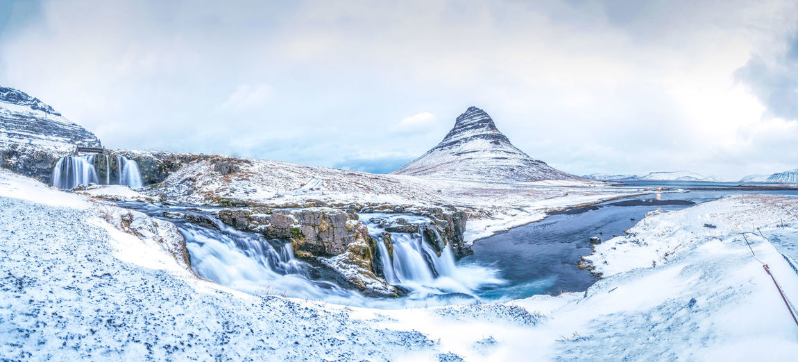 Famous Kirkjufellfoss Waterfalls meets Kirkjufell mountain ♥ Cold Temperature Snow Winter Beauty In Nature Sky Environment Cloud - Sky Mountain Scenics - Nature Landscape Tranquil Scene Nature Tranquility Day Snowcapped Mountain Non-urban Scene Frozen Ice No People Outdoors Mountain Peak Iceland