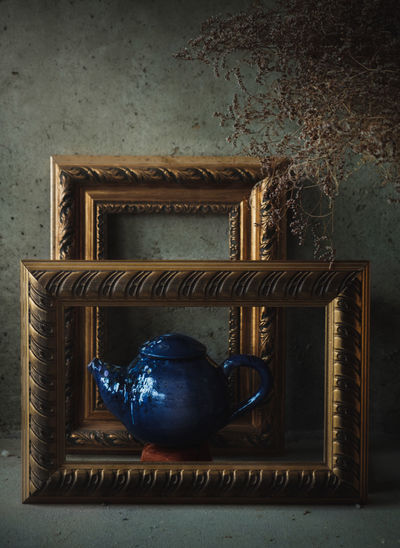 Ceramic blue tea pot in picture frames. Painting-look composed shots. Ode to clay. No People Still Life Close-up Ceramic Art Ceramics Tea Cup Teapot Picture Frame Paintings Art And Craft Kitchen Utensil Pottery Dish Handmade Hand Made Wall Art Rembrandt Light Crafted Beauty darkness and light Low Light Low Key Side View