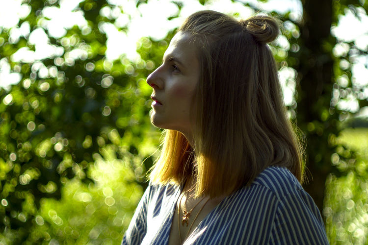 Close-up of thoughtful young woman looking away in park