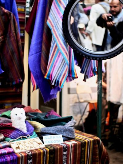 Snatching a Selfie Retail  Choice Market For Sale Market Stall Textile Focus On Foreground Store Clothing Indoors  Representation Alpaca Belfast St George's Market Selfie Colors