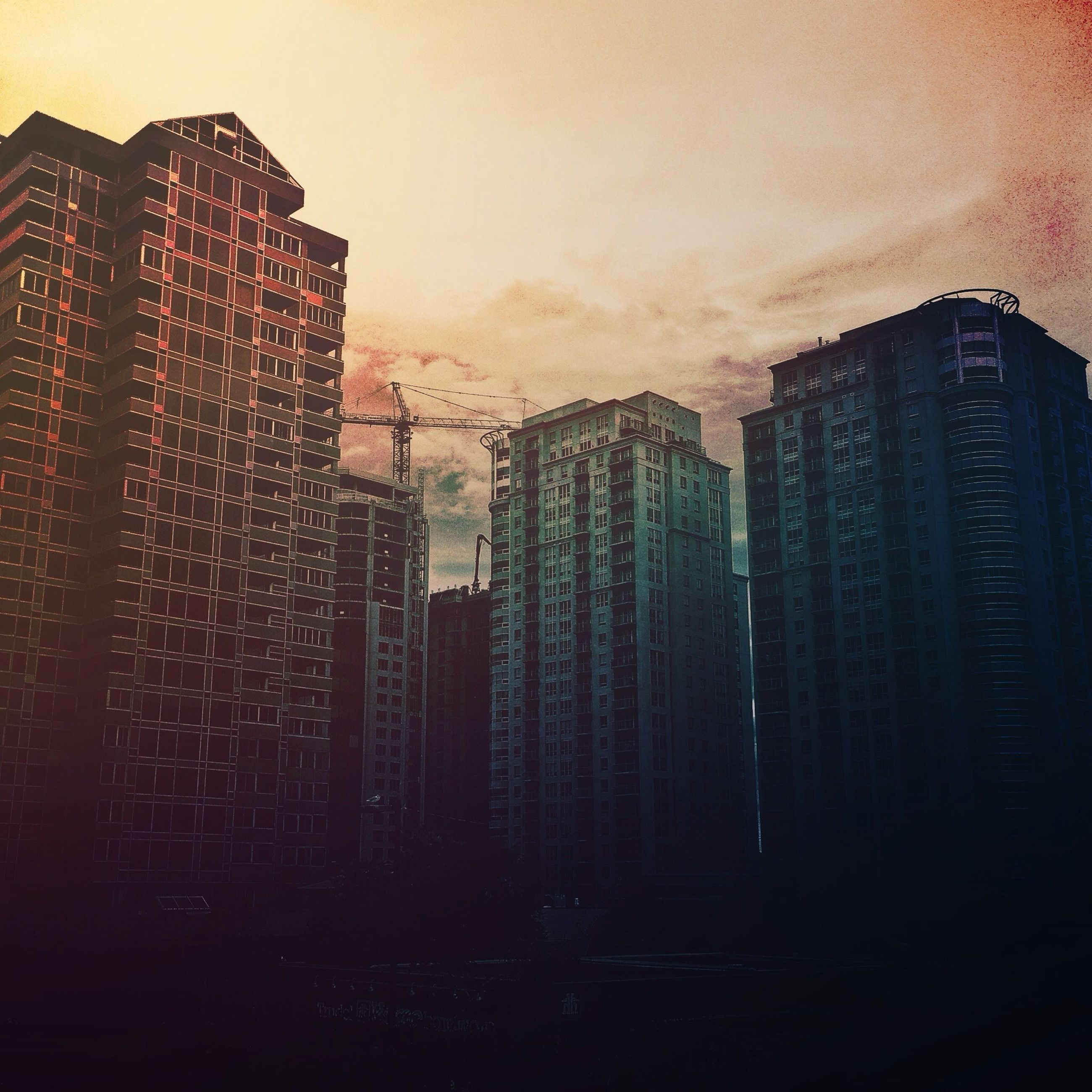 building exterior, architecture, built structure, city, sunset, skyscraper, sky, tall - high, tower, silhouette, cityscape, office building, modern, building, urban skyline, development, orange color, dusk, residential building, no people